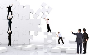business team work building a puzzle isolated over a white background